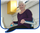 image of a lady on a stairlift